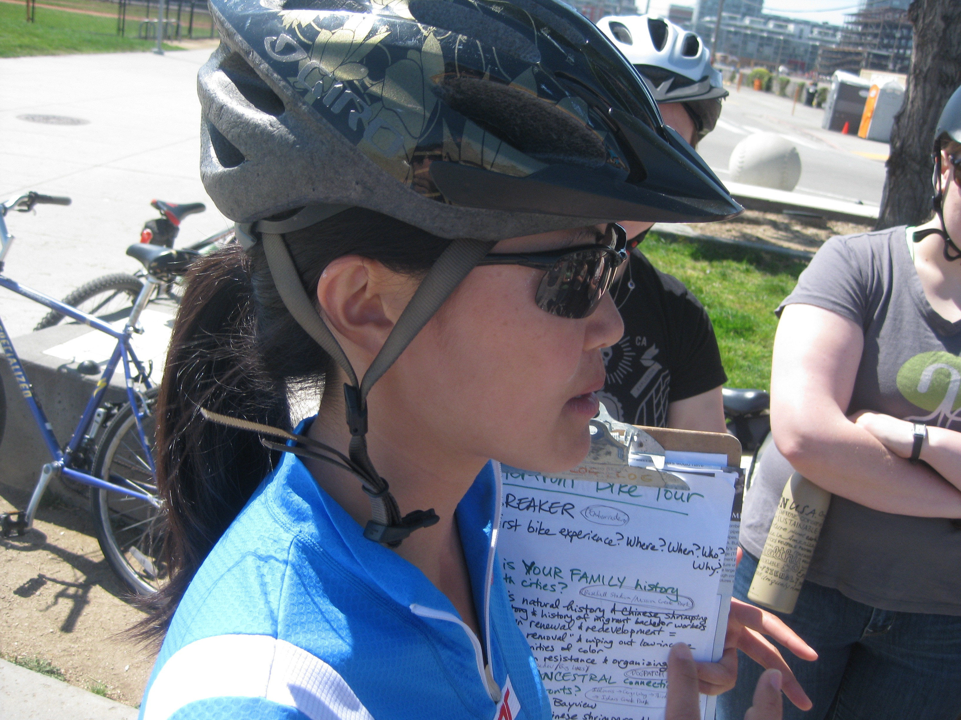 Caption: Tracy Zhu talking to cyclists on her toxic tour, Credit: Laura Flynn