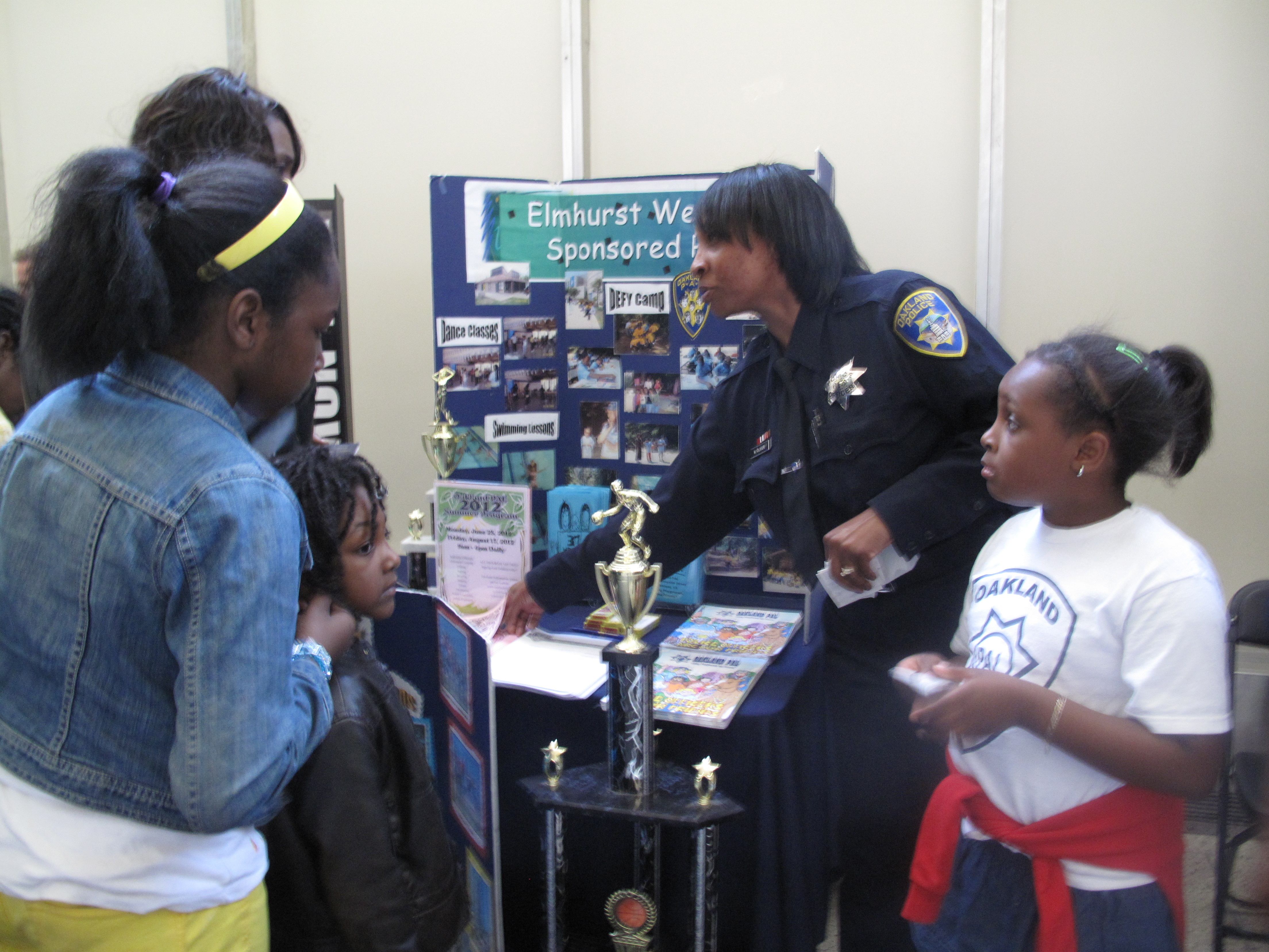 Caption: OPD officers engage with local community members during their annual open house, Credit: Kyung Jin Lee