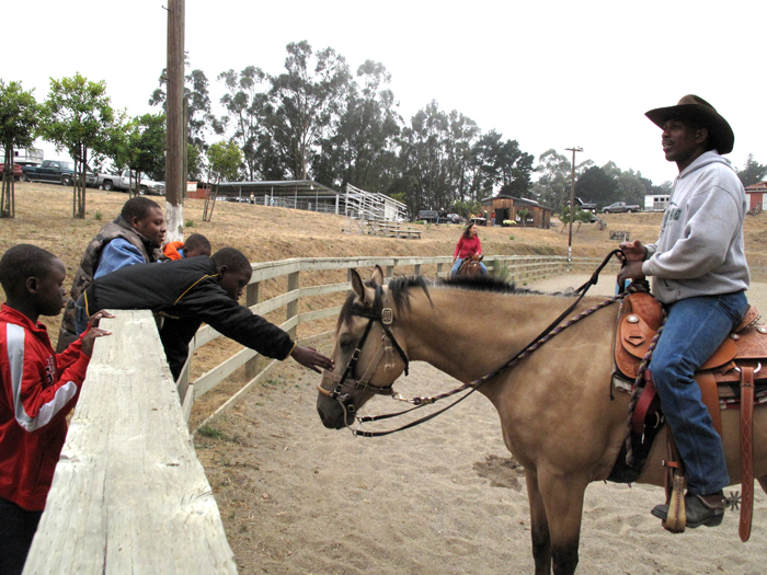 Caption: An Oakland Black Cowboy at the Oakland City Stables, Credit: Julie Caine