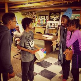 Caption: Young makers play a game of life-size chess at Detroit's Mt. Elliott Makerspace., Credit: Zak Rosen / Michigan Radio