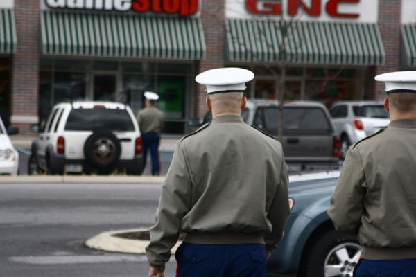 Caption: Recruiters for the U.S. Marines canvass shopping plazas, high schools and job fairs for potential soldiers., Credit: Alexandra Kanik/PublicSource