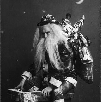 "Caption: ""Caught in the Act"": Santa sits atop a chimney, c1900, Credit: Library of Congress"