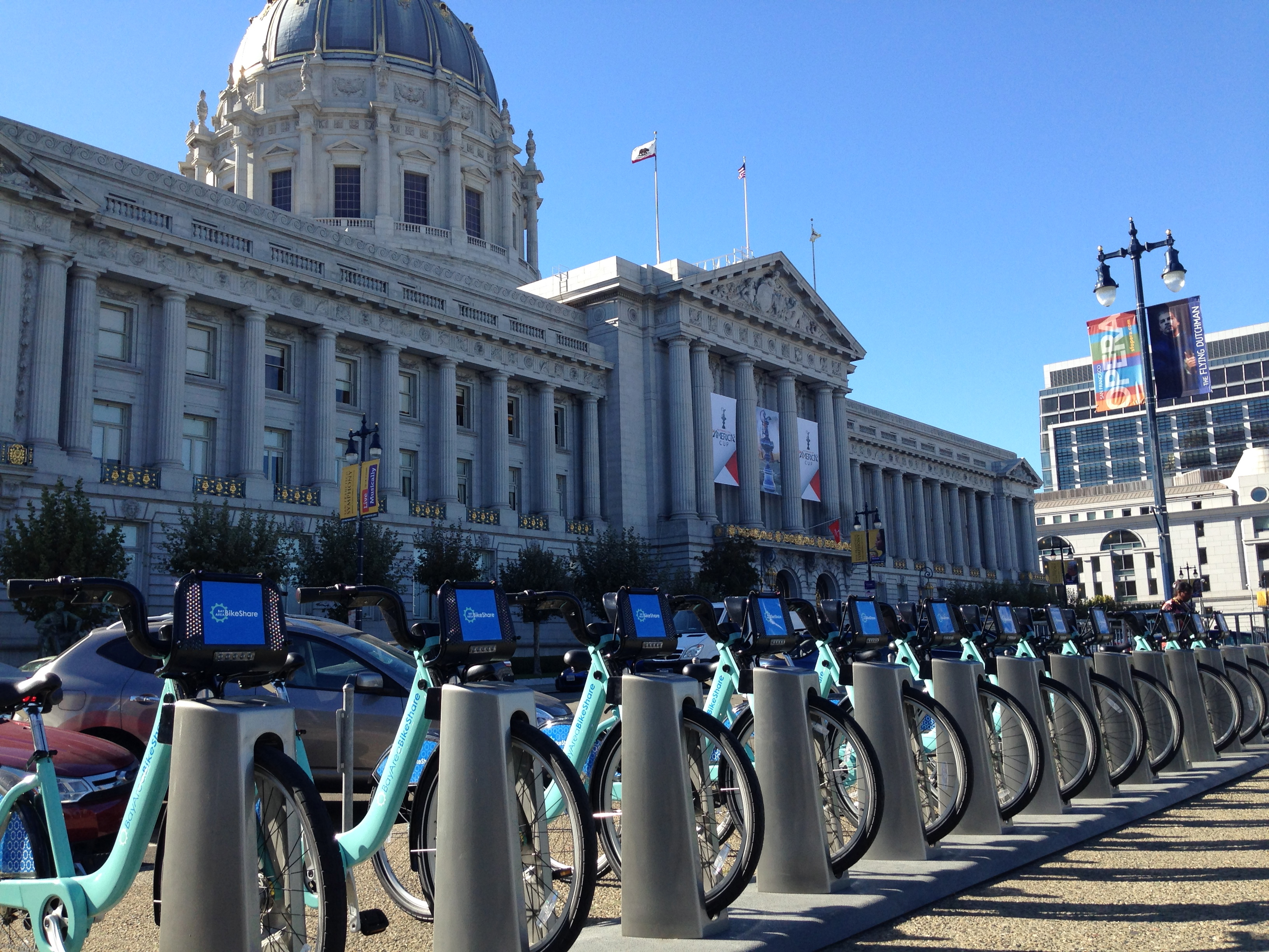 Caption: The Bay Area Bike Share station in front of San Francisco City Hall, Credit: Isabel Angell