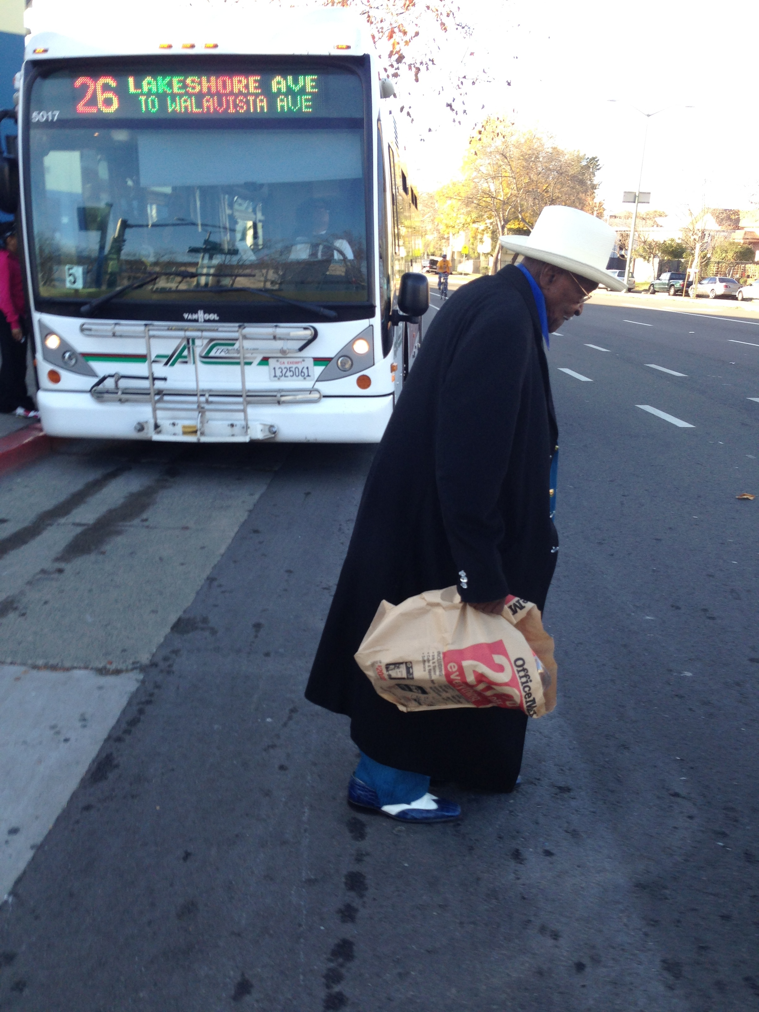 Caption: Long-time AC Transit rider Walter Davis gets off the bus at 14th and Market in Oakland., Credit: Isabel Angell