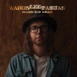 Caption: Aaron Lee Tasjan, Credit: Crooked River Burning album cover