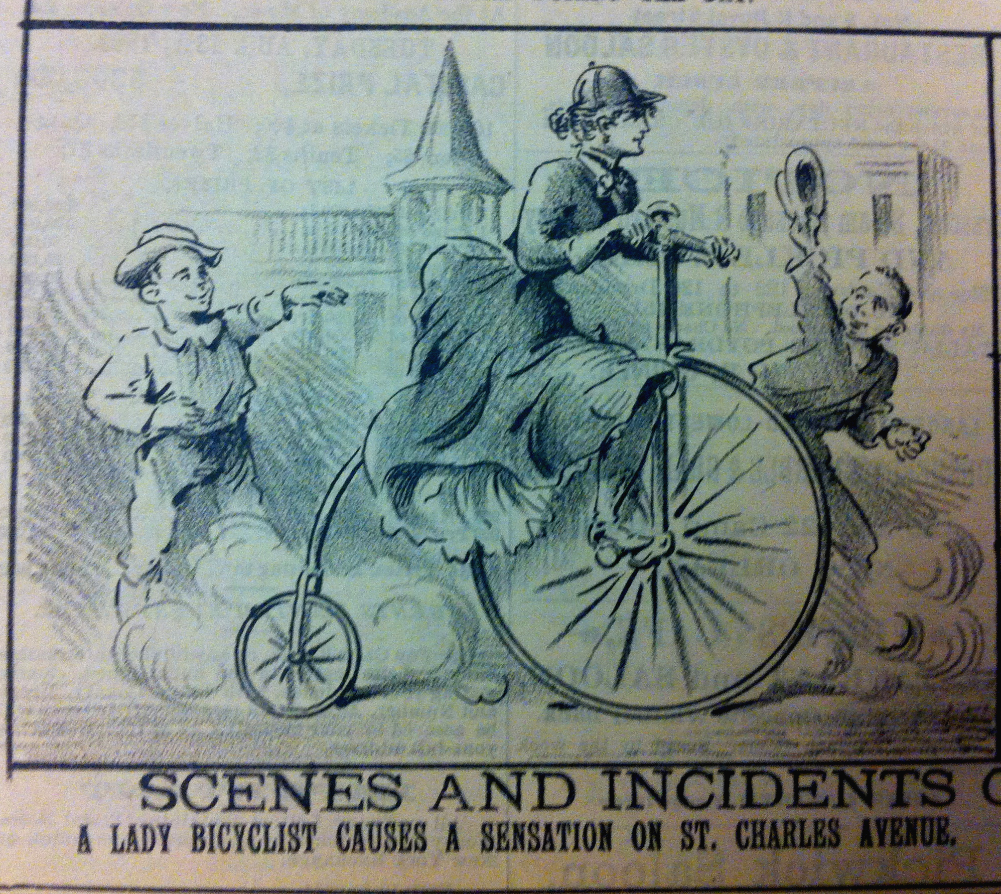 "Caption: Cartoon, ""The Mascot"", New Orleans, 27 July 1891. ""Scenes and Incidents - A Lady Bicyclist Creates a Sensation on St. Charles Avenue""."