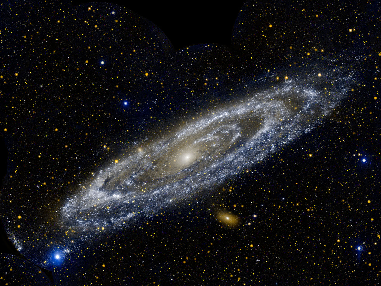 Caption: The Andromeda galaxy is our largest galactic neighbor, measuring 260,000 light-years across., Credit: NASA/JPL-Caltech