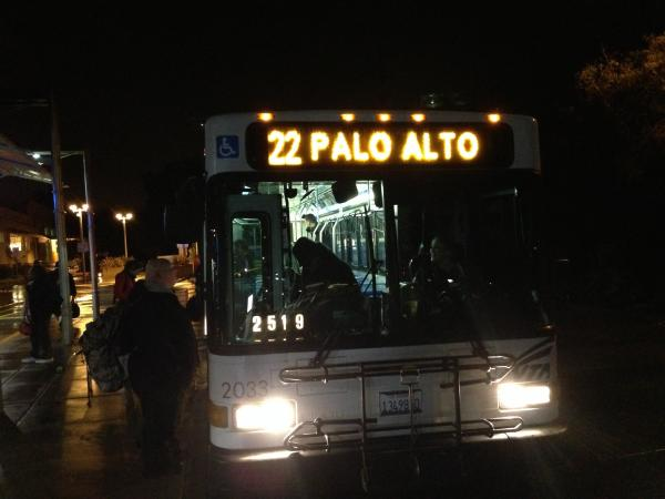Caption: Elizabeth Garber talks to the bus driver at the Palo Alto Transit Center, Credit: Isabel Angell