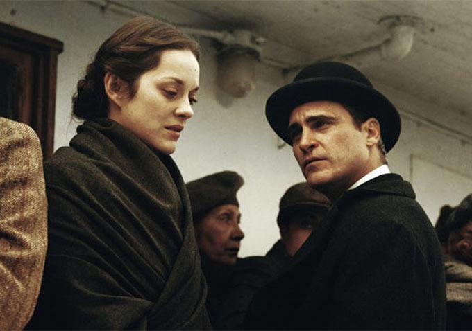 Caption: Marion Cotillard and Joaquin Phoenix in scene from 'The Immigrant'