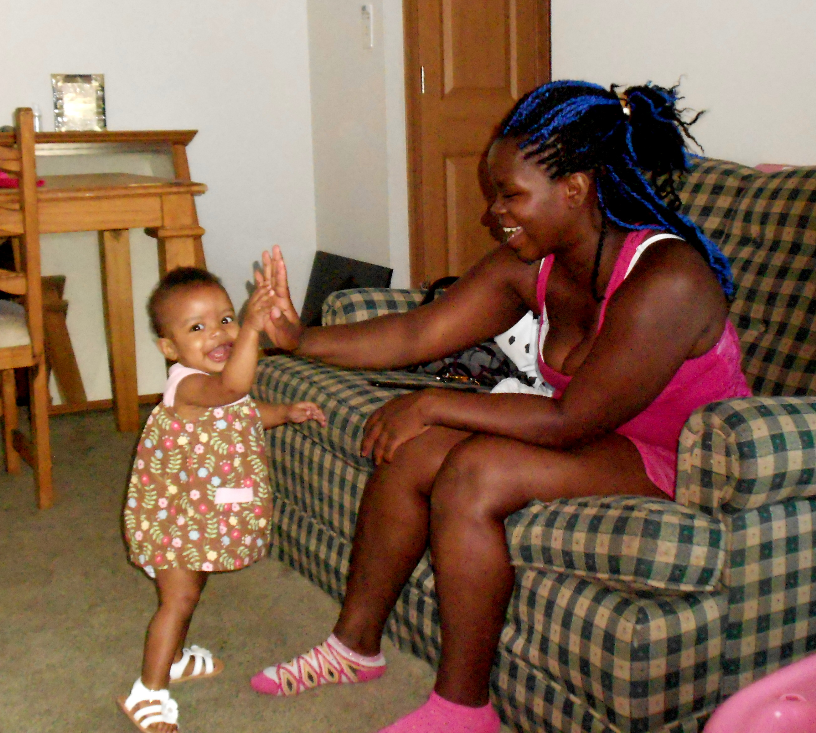 Caption: Natasha Wynn high-fives her daughter, Robin., Credit: Brian Bull, WCPN.
