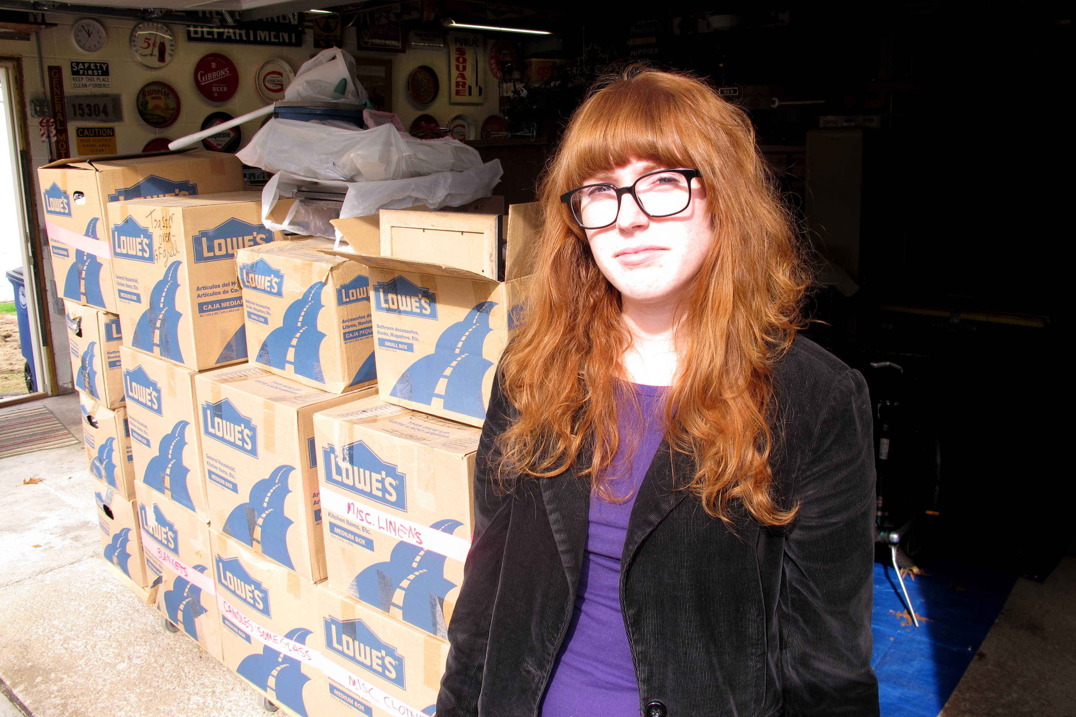 Caption: Bridget Gibbons and her belongings., Credit: Brian Bull, WCPN.