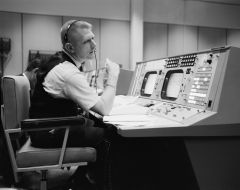 Caption: NASA flight director Eugene F. Kranz at his console in Mission Control in Houston on May 30, 1965, during a Gemini-Titan IV simulation to prepare for the four-day, 62-orbit flight., Credit: NASA