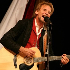 Caption: Hit maker Kenny Loggins performs on the WoodSongs Stage as part of Blue Sky Riders.