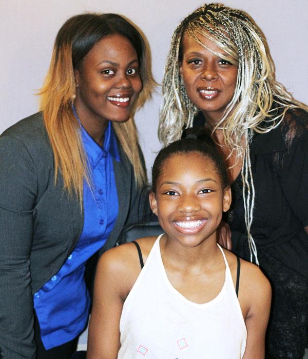 Caption: Aja (left), Kai (middle) and their mother Tonya David.
