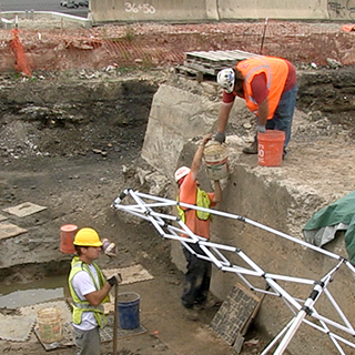 Caption: URS Corporation archaeologists excavate at a site beside I-95 in the Fishtown neighborhood of Philadelphia., Credit: Mariel Carr