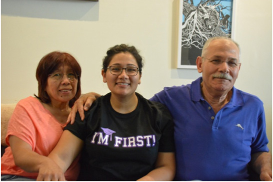 Caption:  A graduate and her parents celebrate first-generation college students at Amherst College., Credit: Photo by Suzanne Pekow