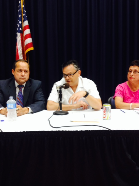 Caption: Dr. Daniel King, Dr. Francisco Guajardo, and Dr. Frances Guzman on the panel., Credit: Samuel Orozco/Radio Bilingüe