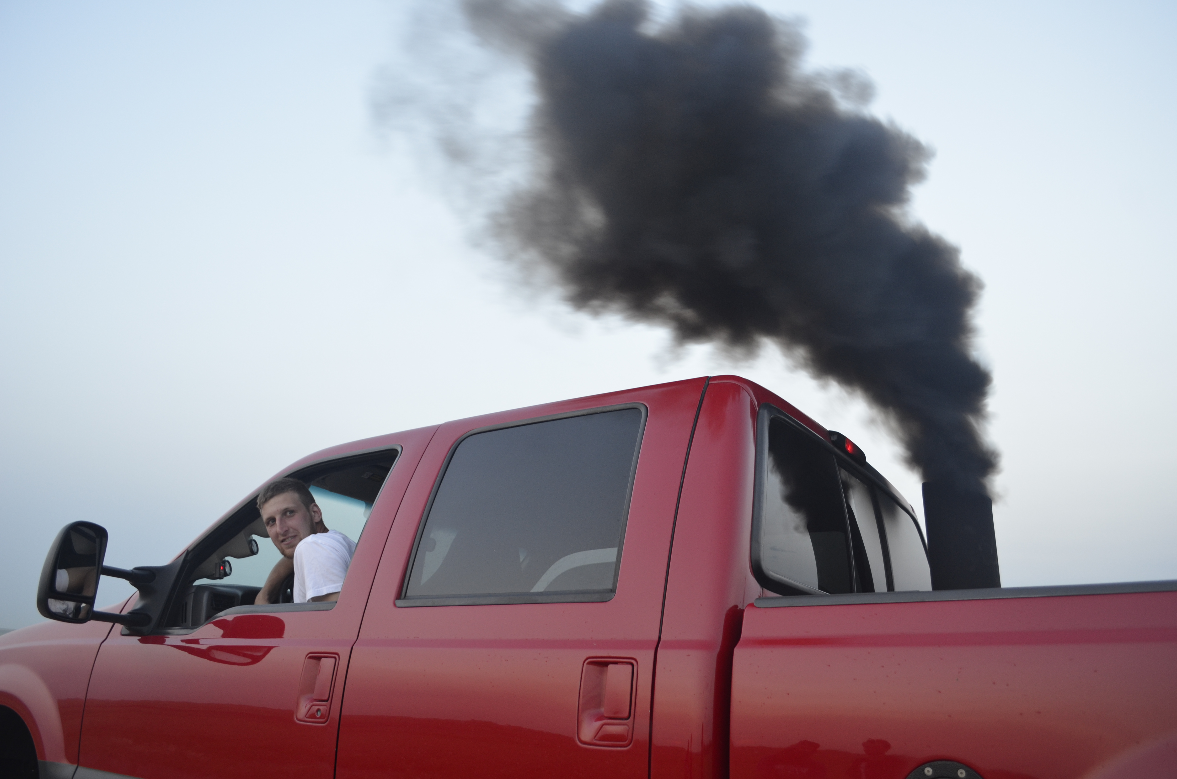 Caption: Calvin Fields rollin' coal in Williston, North Dakota., Credit: Todd Melby