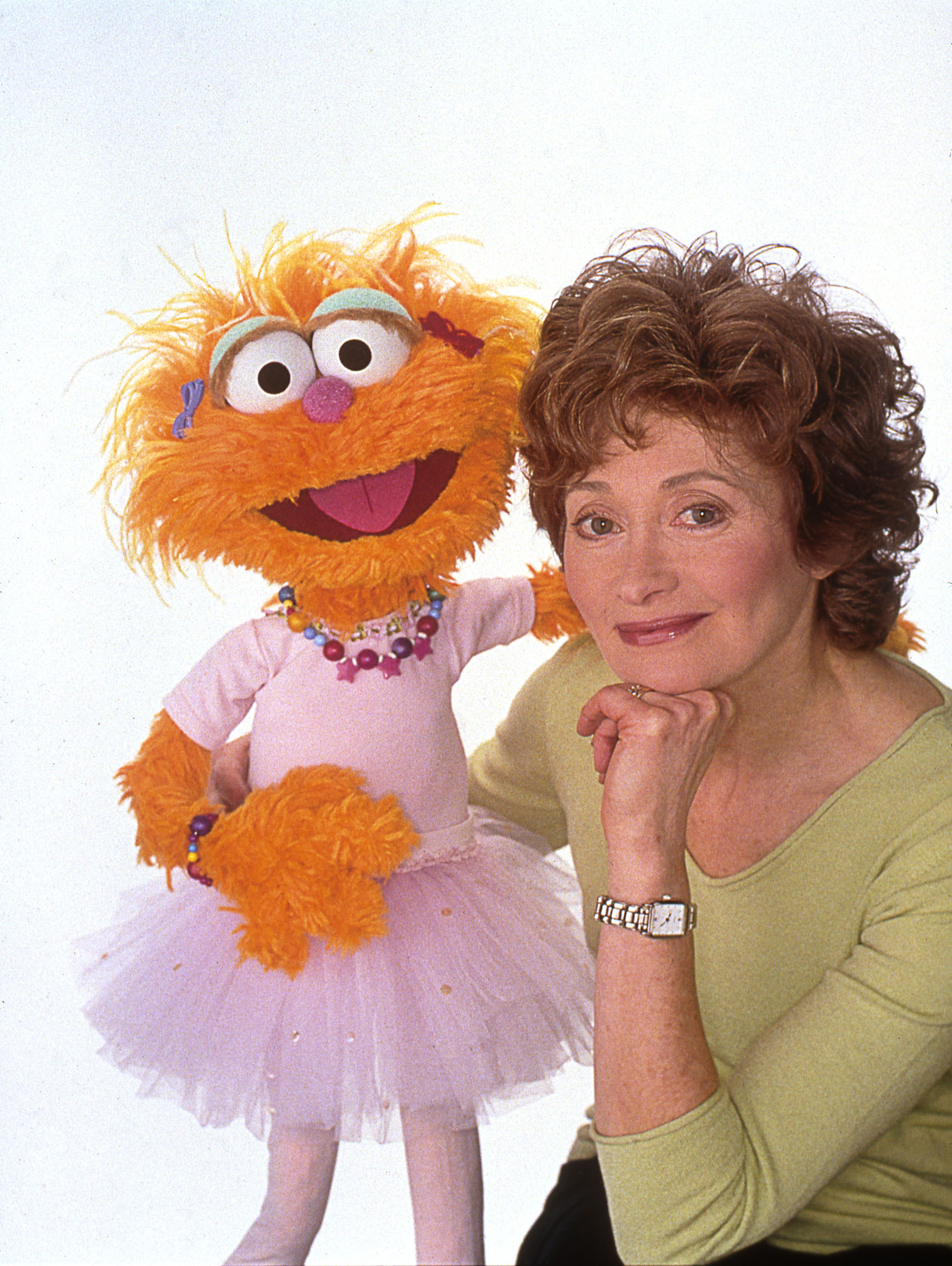 Caption: Five-time Emmy Award winner Fran Brill, the first woman hired by Jim Henson for Sesame Street (seen here with Zoe) is retiring after 42 years , Credit: Jim Henson Legacy
