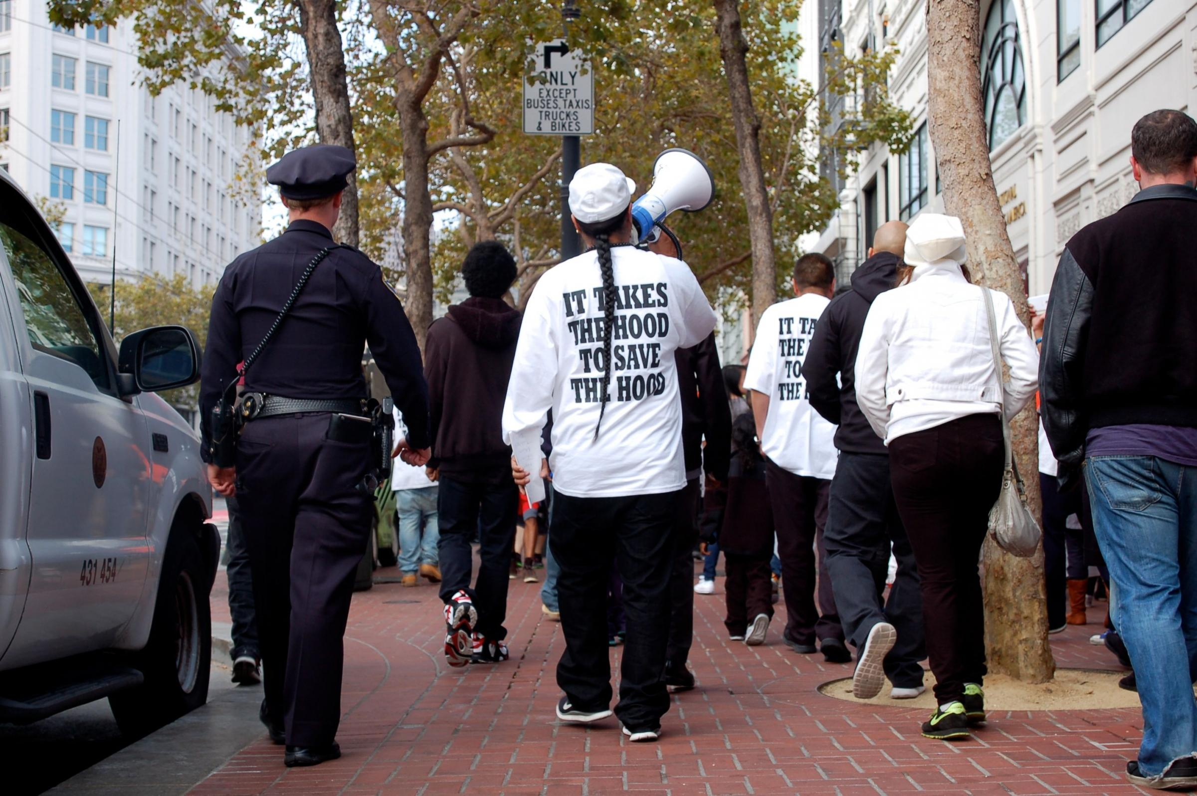 Caption: Rudy Corpuz, Jr. (center) leads a Silence to Violence march down Market Street on September 4, 2014., Credit: Anna Kolhede