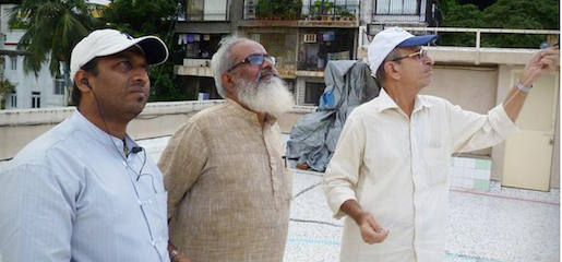 Caption: Kite maker Abdul Rauf (center) with Dilip Kapadia (right) flying a kite on a Mumbai rooftop, Credit: Adi Narayan