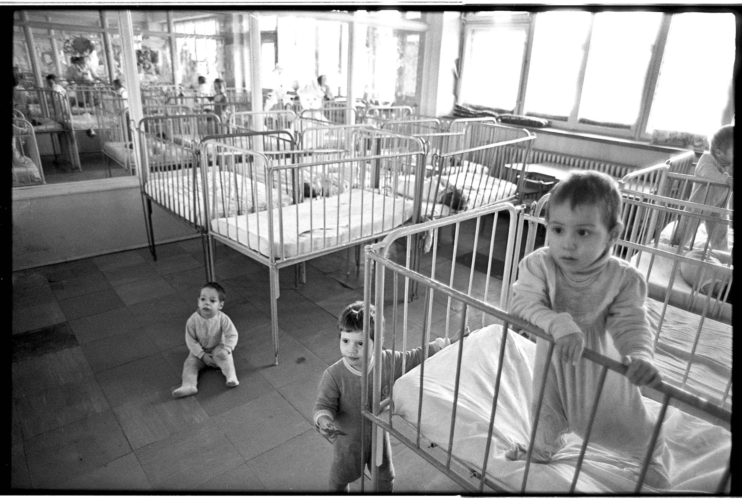 Caption: Orphans in Romania., Credit: Mike Carroll for Harvard University