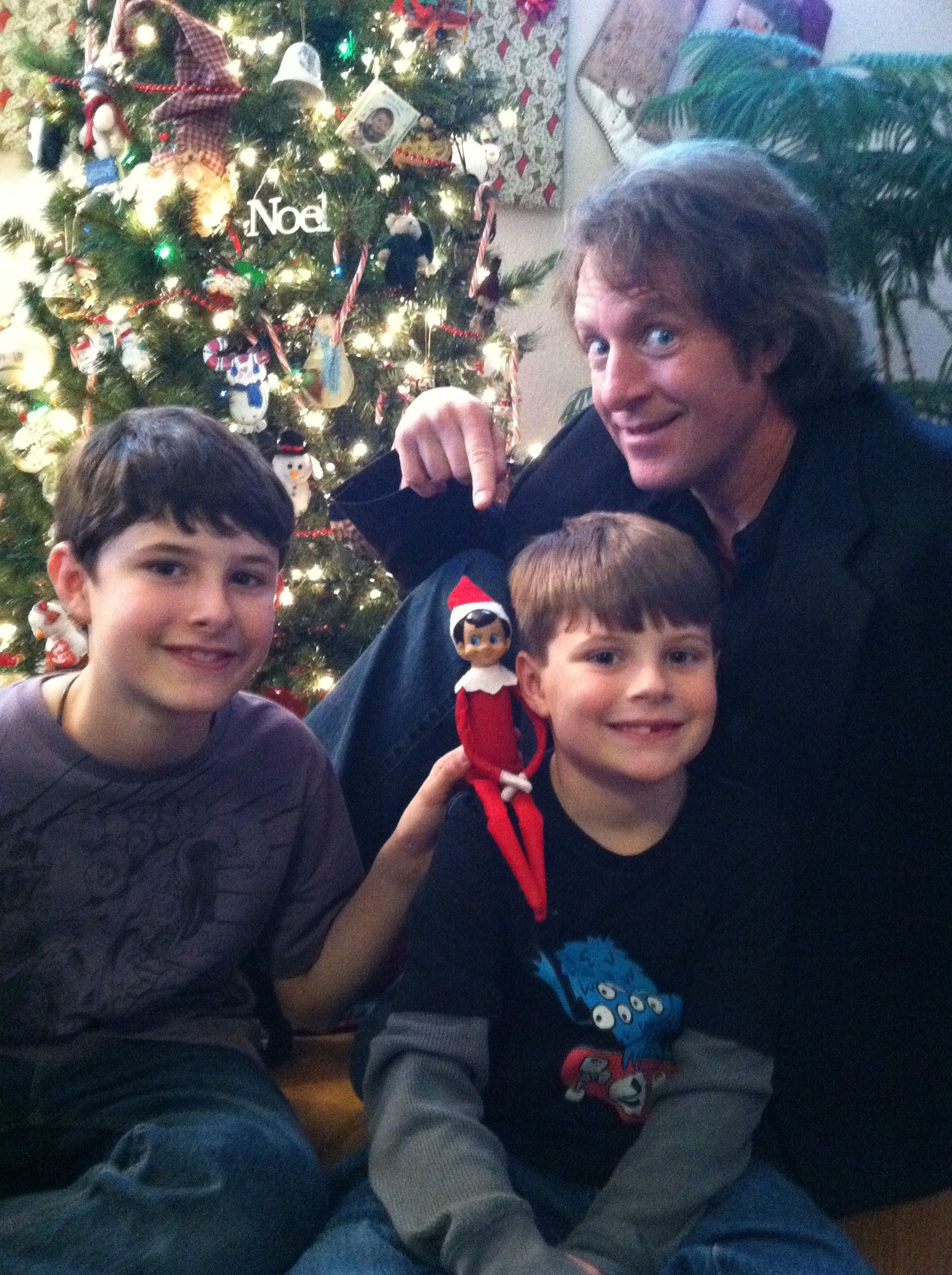 Caption: Brett, Elam and Me…and the Elf on a Shoulder!
