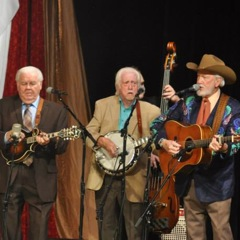 Caption: Bluegrass legends JD Crowe, Doyle Lawson and Paul Williams on the WoodSongs stage.