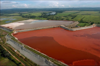 Caption: Remember the toxic red sludge chemical disaster, 2010, in Hungary? This photo shows a reservoir containing red mud of an alumina factory near Ajka, Hungary, 2006., Credit: EPA | Sandor H. Szabo