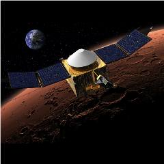 Caption: The MAVEN spacecraft circling Mars., Credit: NASA/GSFC