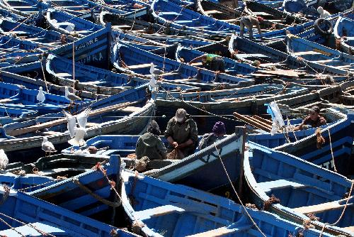 Caption: Boats cluster together in a Moroccan port., Credit: Mike Markovina | Marine Photobank
