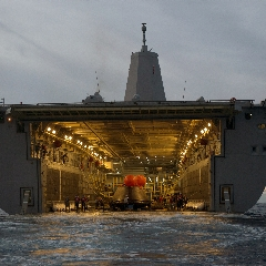 Caption: Orion spacecraft is recovered by the USS Anchorage, Credit: NASA