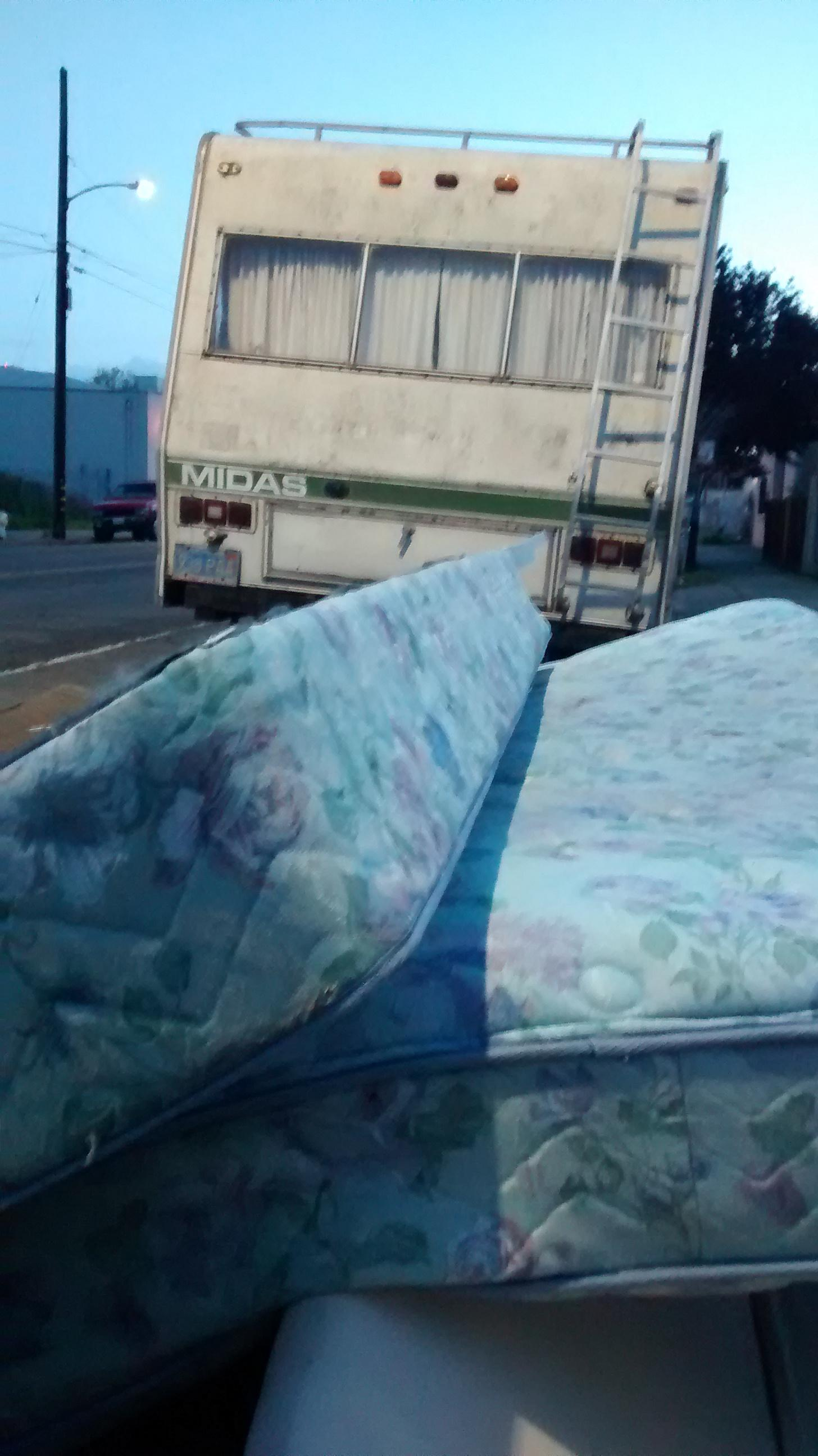 Caption: A mountain of mattresses in West Oakland, Credit: Todd Whitney