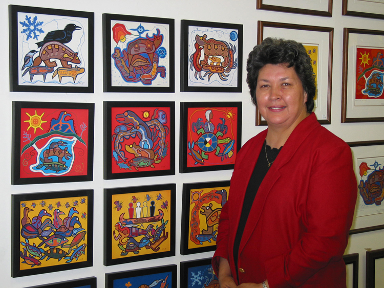 Caption: Louise Thomas with work by Roy Thomas, Credit: Louise Thomas