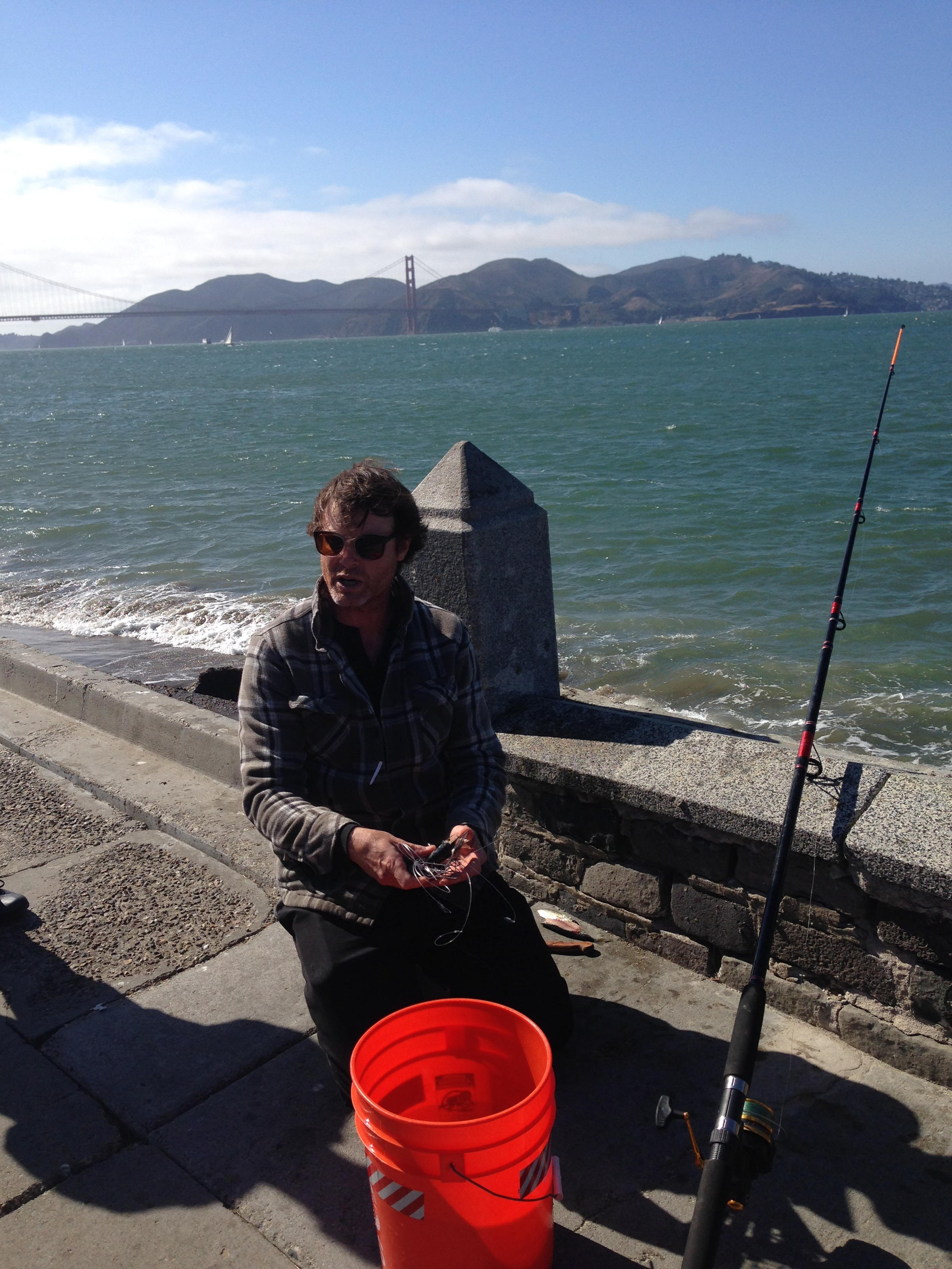 Caption: Kirk Lombard explaining how to catch crab from the Bay , Credit: Angela Johnston