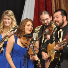 Caption: the students of The Kentucky Center for Traditional Music perform on the WoodSongs Stage.