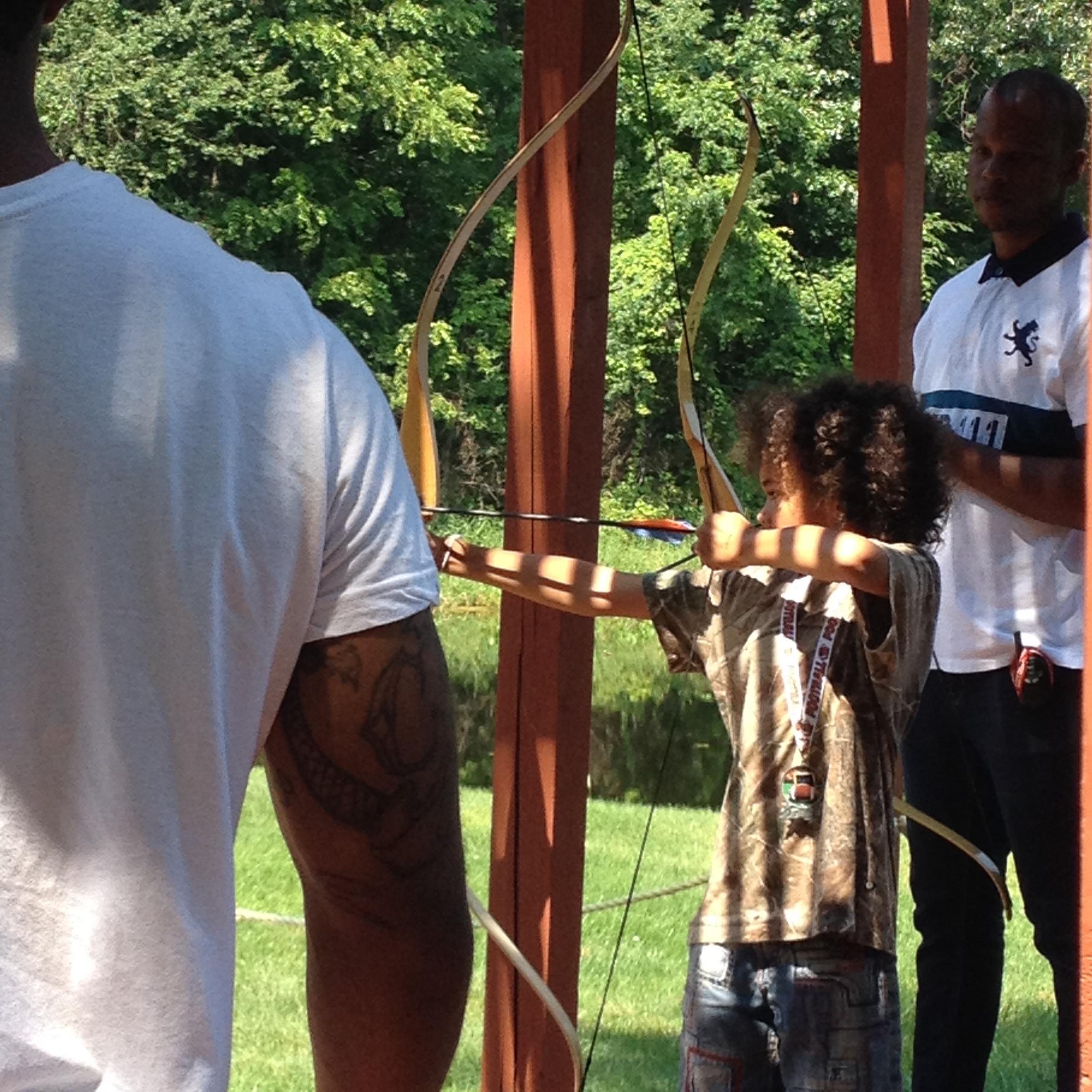 Caption: Detroit students get to practice archery at Camp Burt Shurly., Credit: JENNIFER GUERRA / MICHIGAN RADIO