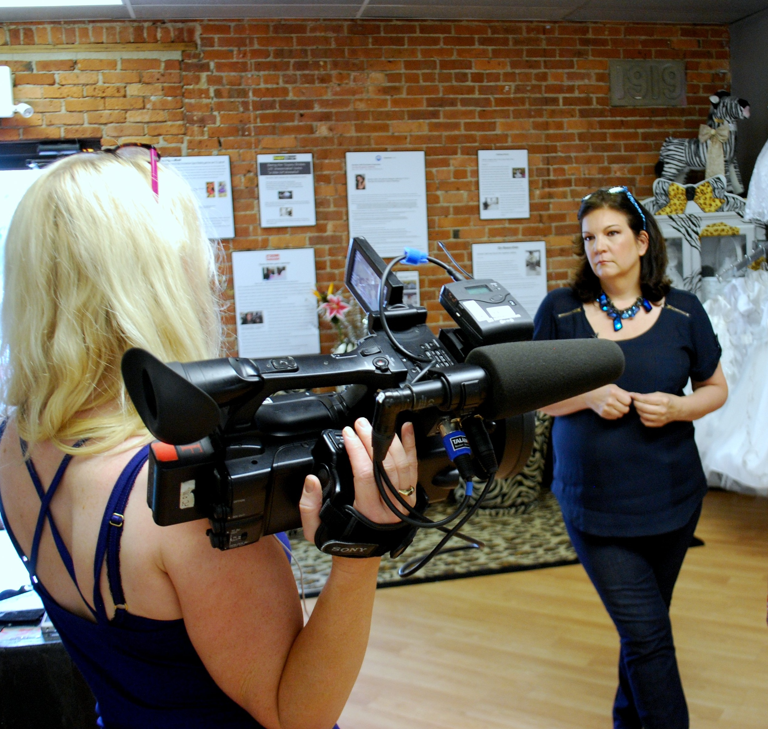 Caption: Sondra talking to photog, Credit: Sondra Celli