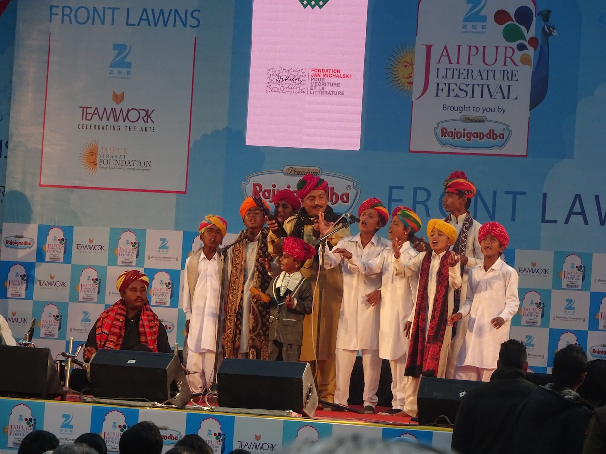 Caption: Kids singing at the Jaipur Lit. Fest.