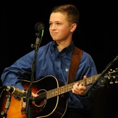 Caption: 14 year old National Thumbpicking Champion Parker Hastings performs on WoodSongs.
