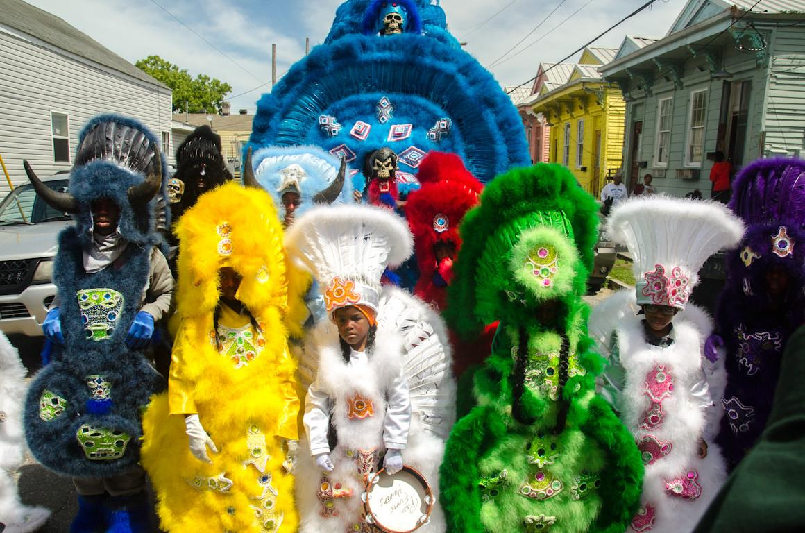 Caption: The Red Flame Hunters All-Youth Mardi Gras Indian Tribe, Credit: https://www.facebook.com/redflamehunters