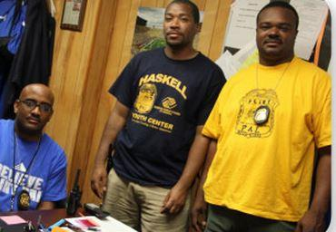 Caption: Officer Jesse Carpenter, left, and staff of the Haskell Youth Center in Flint., Credit: HASKELL CENTER