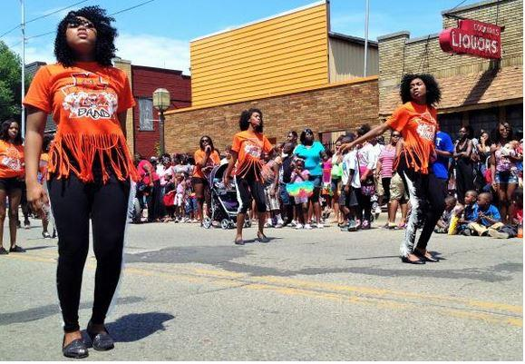 Caption: Dancers from the Muskegon Heights High School Academy perform during the Festival in the Park parade earlier this summer., Credit: DUSTIN DWYER / MICHIGAN RADIO