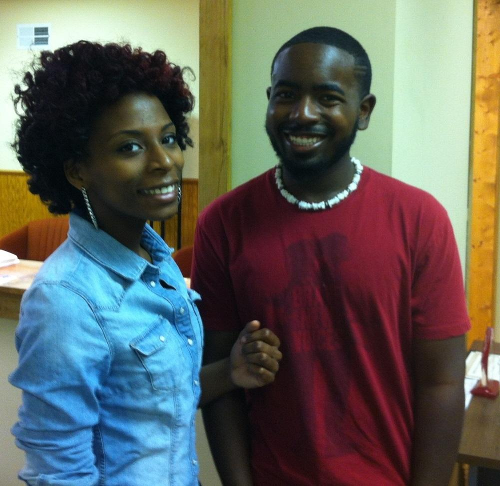 Caption: Yazmen Brown (left) and JaCquell Price, college students and slam poets from Flint., Credit: SARAH ALVAREZ