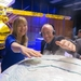 Caption: Cassini Saturn mission Project Scientist and host Mat Kaplan touch the plumes of Enceladus at JPL., Credit: Merc Boyan, The Planetary Society