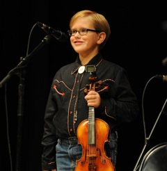 Caption: Fiddlin John Maupin is only 8 years old and our WoodSongs Kid of week.