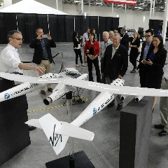 Caption: Elected officials hear about Virgin Galactic's LauncherOne rocket and WhiteKnightTwo air launch vehicle., Credit: Virgin Galactic