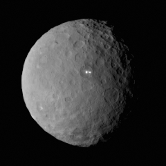 """Caption: One of the best images so far of dwarf planet Ceres, centered on the mysterious """"bright spots."""", Credit: NASA / JPL / UCLA / MPS / DLR / IDA"""