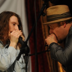 Caption: Harmonica master John Nemeth jams with our WoodSongs Kid Carson Diersing.