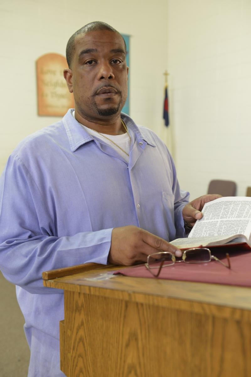 Caption: Derrick Holloway serves as an inmate preacher in San Quentin State Prison., Credit: Nigel Poor